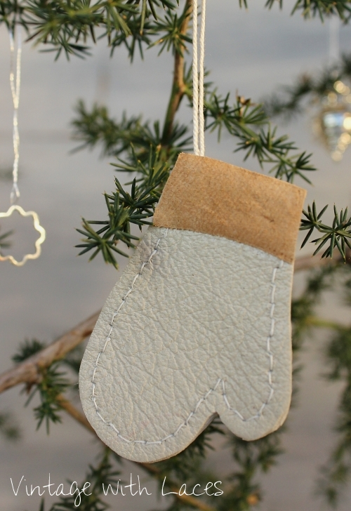 Small Christmas mitten ornament made out of leather scraps by Vintage with Laces