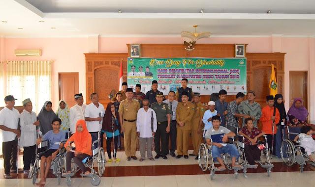 Hari Disabilitas Internasional 2018, Bupati Tebo Bagikan 61 Alat Bantu Bagi Penyandang Disabilitas