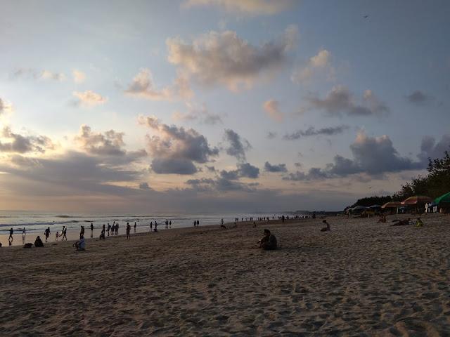 Sloping and long beach in Kuta