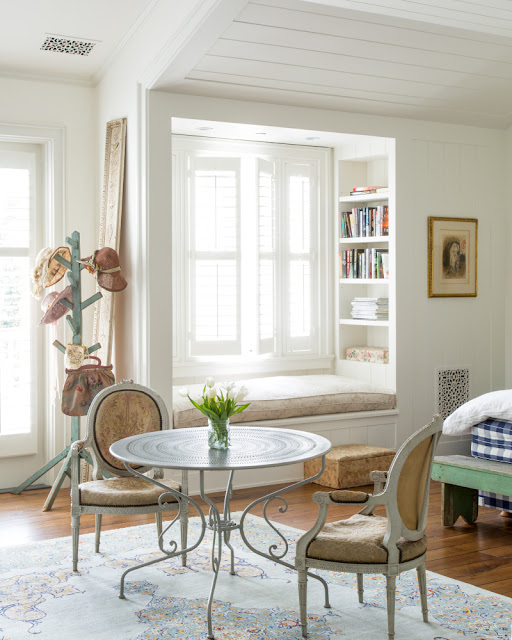 Charming cottage style bedroom with window seat with decor by Samantha O'Connor