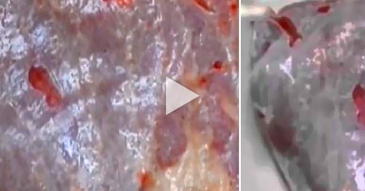 Pulsating raw meat shocks a Woman buyer in China