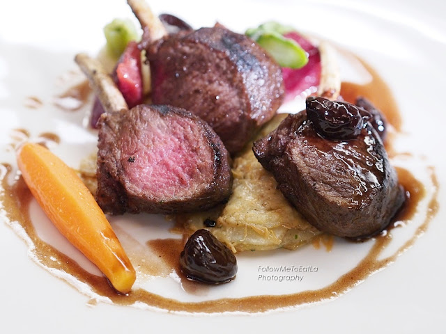 Slow-Cooked Lamb Cutlet, Baked Stuffed Red Onion, Glazed Root Vegetables and a Jus Of Cherry
