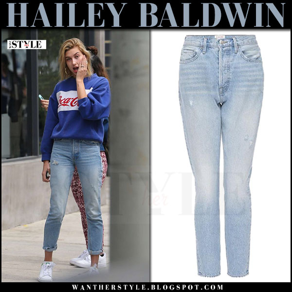 Hailey Baldwin in blue coca cola sweatshirt, ripped jeans and white sneakers what she wore march 2017