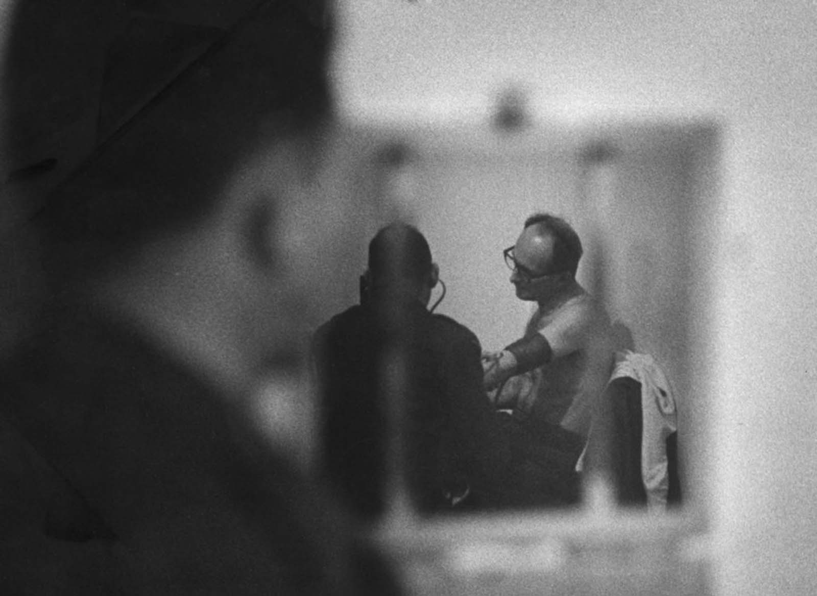 A medical check after breakfast, watched by a guard, was part of Eichmann's daily routine.