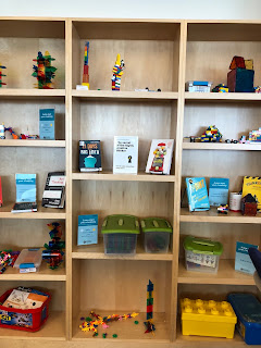 shelves of building toys: Lego, tinker toys, blocks