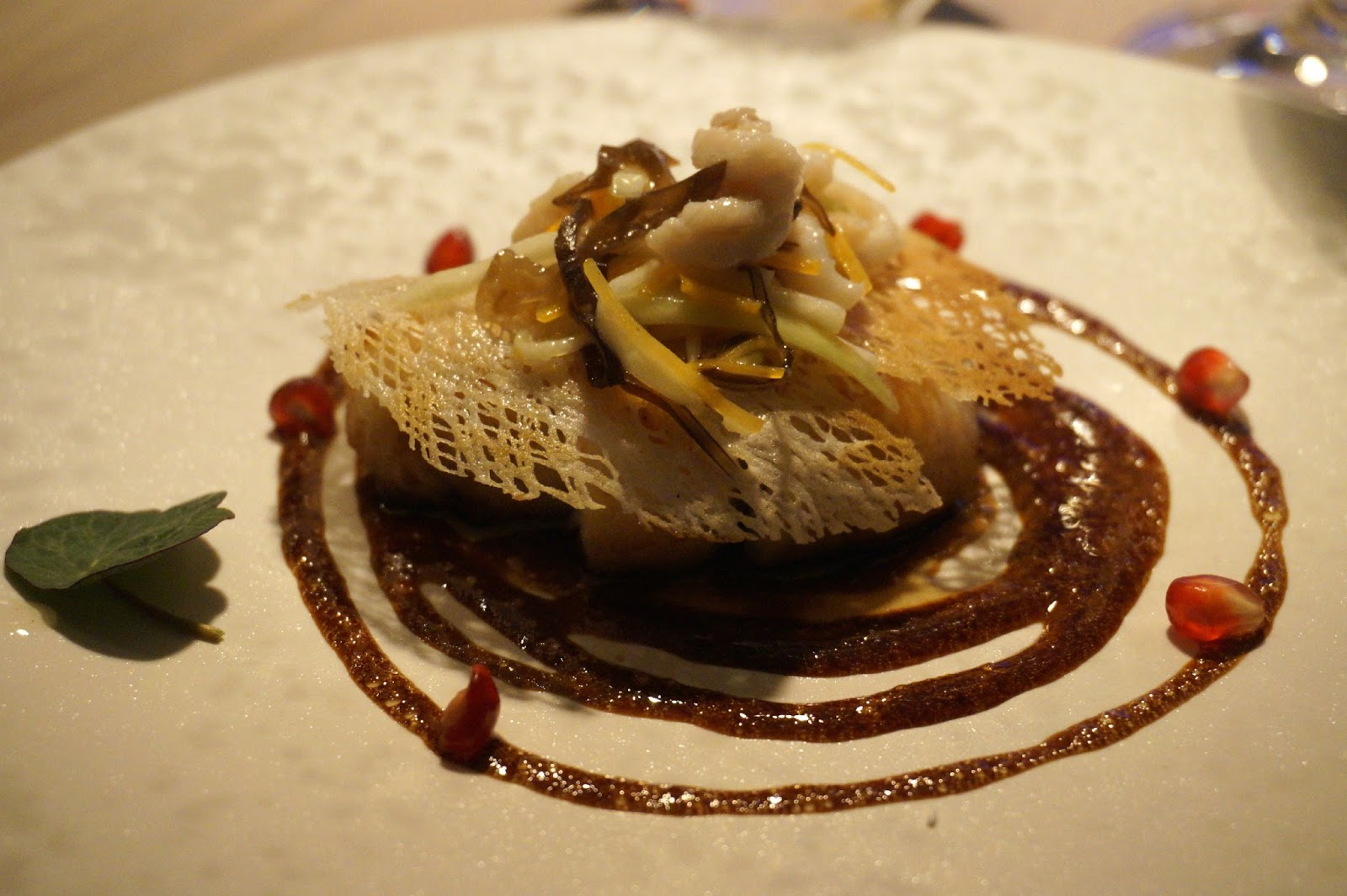 Wok-fried seabass fillet served on rice paper with a balsamic vinegar, black truffle and pomegranate reduction