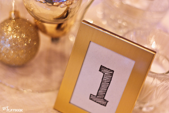 These gold ornament table numbers are one of a kind and festive.