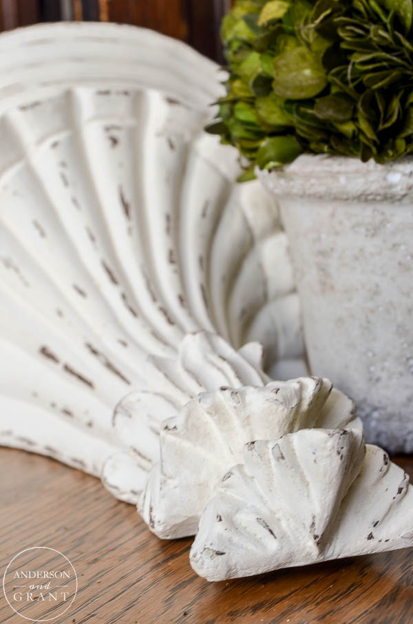 See the makeover that two plastic shelves got with a little chalk paint to create some reproduction architectural salvage corbels.  |  www.andersonandgrant.com