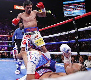 Manny Pacquiao becomes the oldest welterweight champion to beat Keith Thurman at 40.
