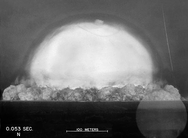 The expanding fireball and shockwave of the Trinity explosion, seen .053 seconds after detonation on July 16, 1945.