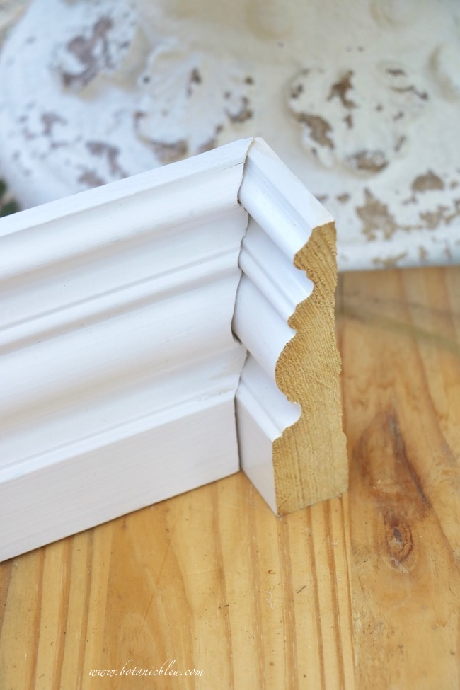 small white vanity area in master bathroom baseboards corner coped to fit adjoining baseboard