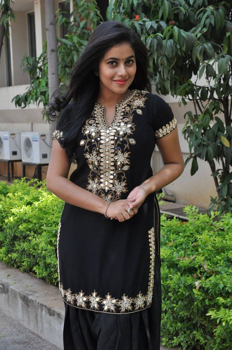 Poorna Long Hair In Black Dress In Film Success Meet