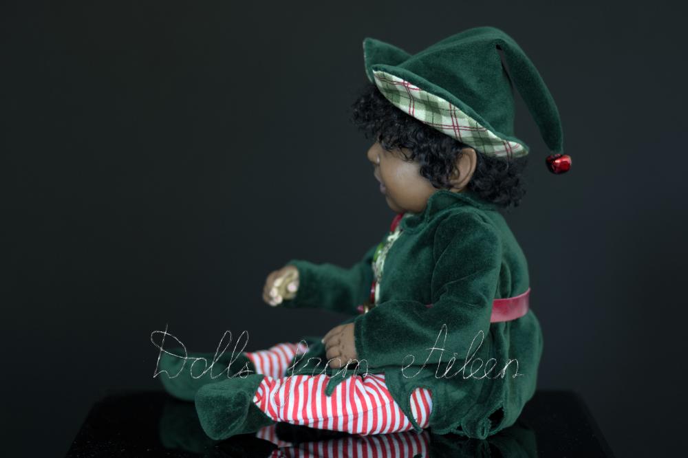 ooak Christmas elf art doll in profile