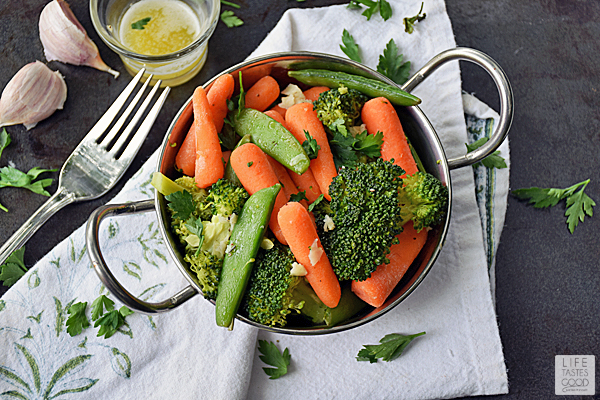 Fresh vegetables steamed to perfection and drizzled in garlic butter | by Life Tastes Good is an easy to make side dish, but I find myself snacking on these addicting veggies all the time!