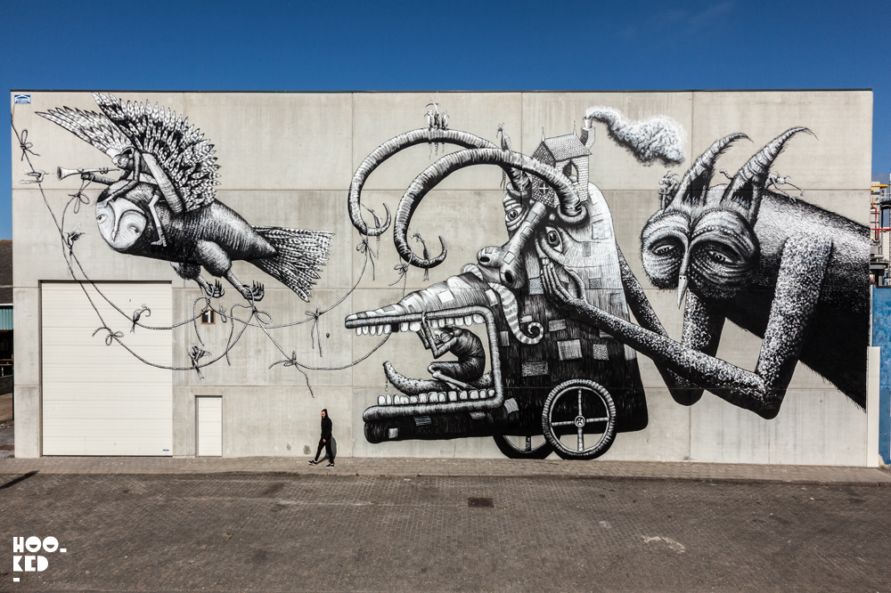Black and white mural featuring birds and creatures by artist Phlegm