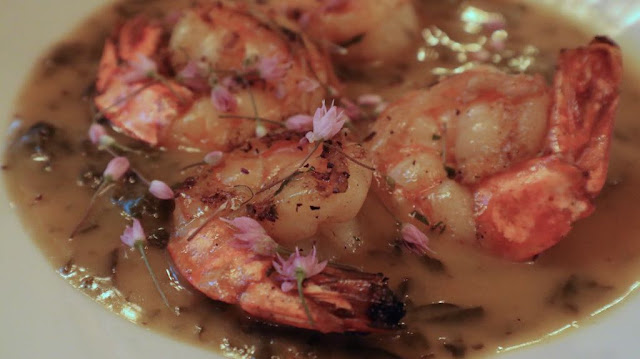 grilled prawns in a coconut taro leaf curry