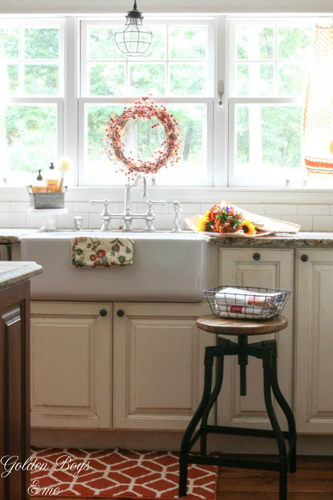Farmhouse sink with caged light pendant and fall wreath - www.goldenboysandme.com