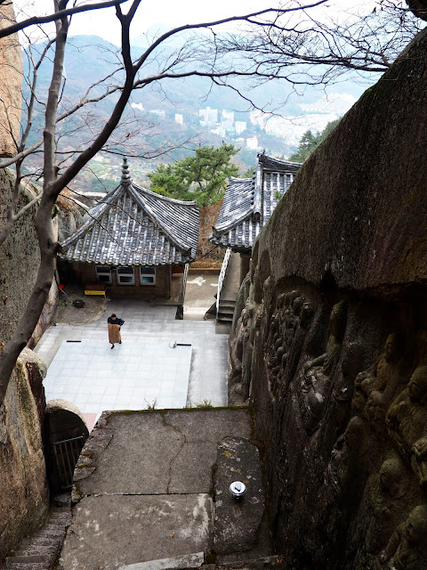 Looking down on the prayer of Seokbulsa Temple, built into the side of Geumjeongsan Mountain, Busan, South Korea