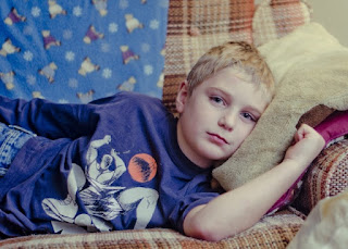 young boy on sofa