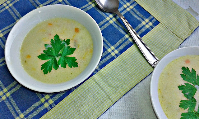 white creamy suop with carrots and potatoes