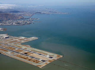 Half of the San Francisco Airport runways could be submerged by rising seas this century, a study shows.  (Photo Credit: Shaw/Getty Images) Click to Enlarge.