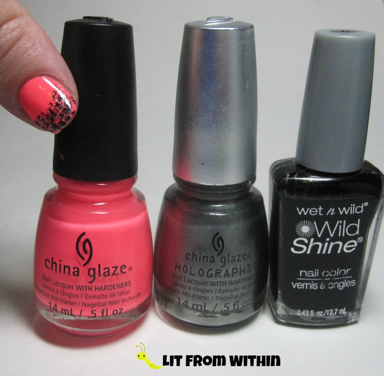 Bottle shot:  China Glaze Thistle Do Nicely, China Glaze Cosmic Dust, and Wet 'n Wild Black Creme.