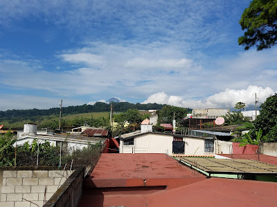 view of volcano from roof in Guatemala
