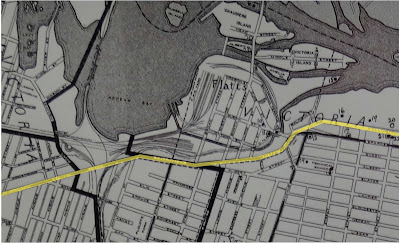 1940 Map of Ottawa, closeup of LeBreton Flats neighbourhood with Wellington Street highlighted across it with a yellow line.