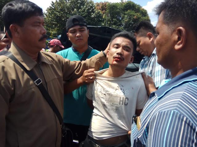 Tersangka pelaku perampokan toko Emas di Labura yang menabrak orang di Asahan.