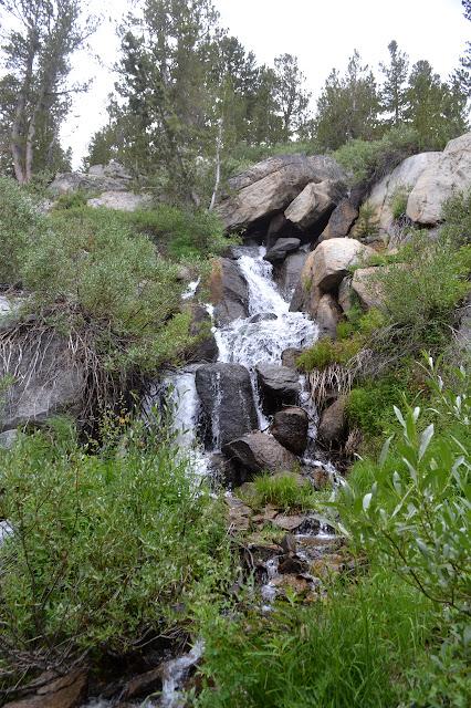 water rushing down boulders