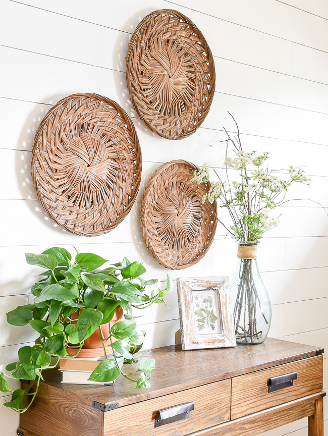 Gallery wall of round flat weave baskets