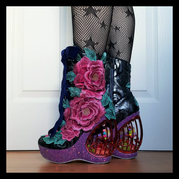 wearing Irregular Choice floral Maya boots with birdcage detail shown