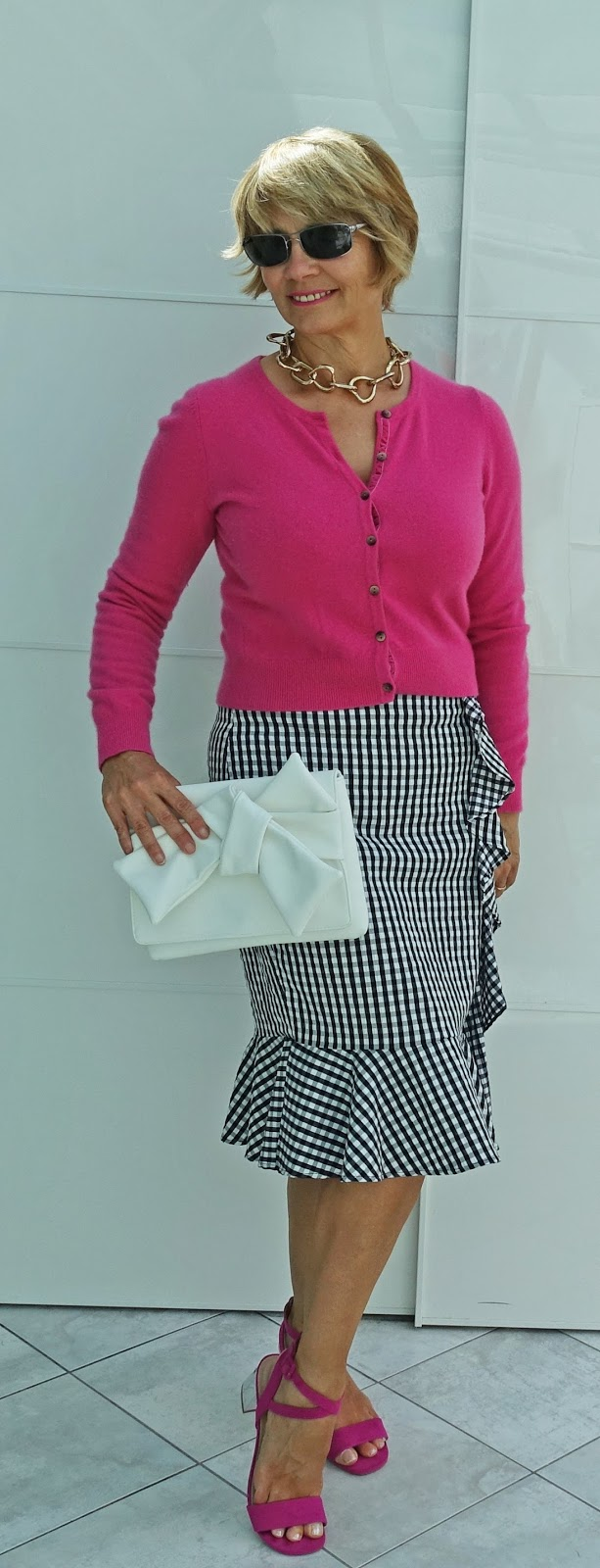 Black and white gingham goes with anything, and fuchsia pink is always a striking colour to choose. Pair it with a white clutch and block heeled pink sandals.
