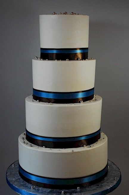 blue and brown wedding cakes cup a cakes brown and blue ribbon wedding cake 11942