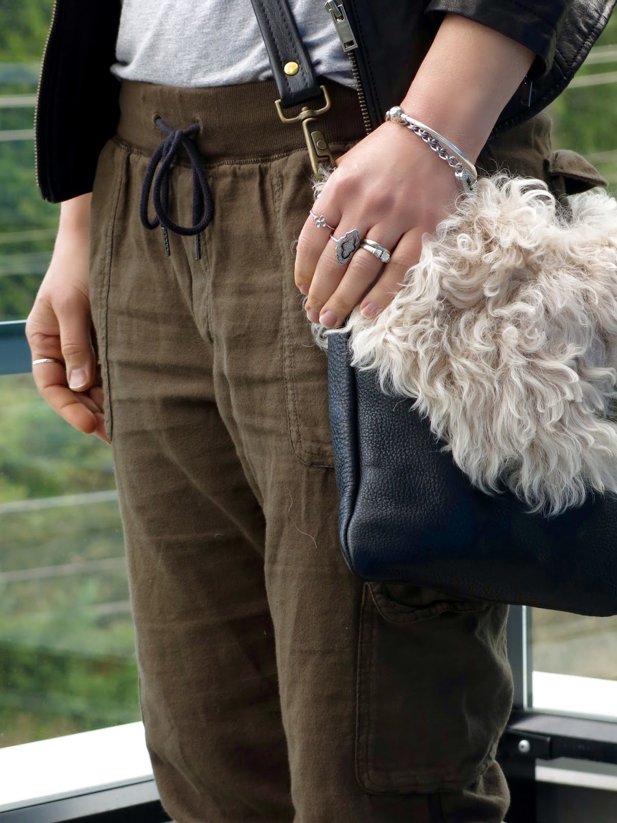 "slouchy cargo pants, ""sherpa"" bag"