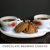 A bite of chocolate brownie with a chocolate espresso glaze in each cookie.