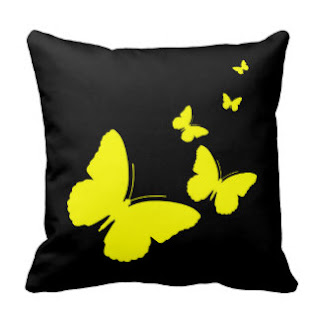 Yellow on black butterflies throw pillow