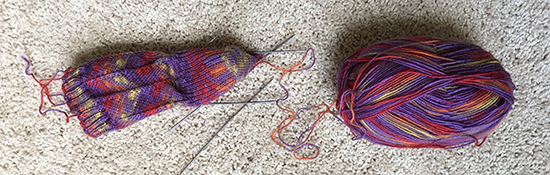 Purple Hand Knit Socks in Progress with Regia Yarn