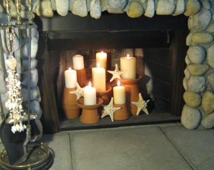 candles with starfish in fireplace