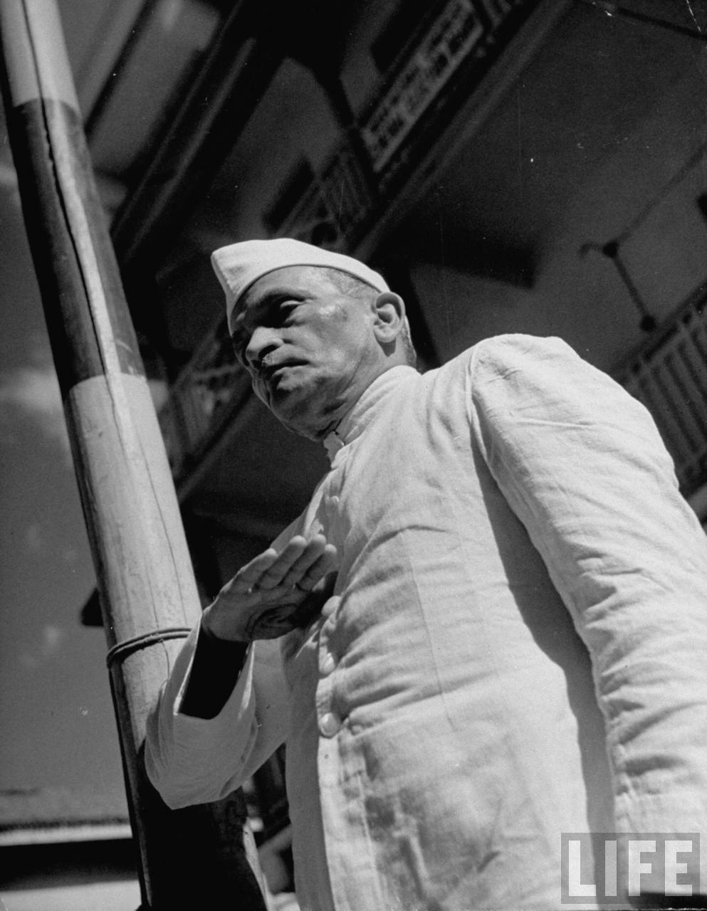Nagindas Master, India's Congress Committee Head, saluting the Congress flag - Bombay 1946