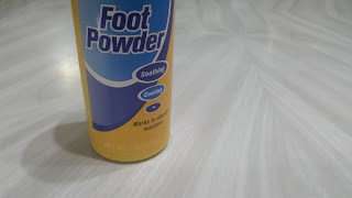 Foot powder in a yellow plastic bottle