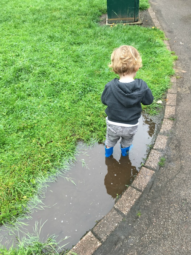 toddler-stood-in-muddy-puddle