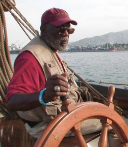 Capt. William Bill Pinkney at the helm of his sailboat