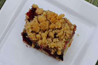 top of the black berry crumb cake on a white plate