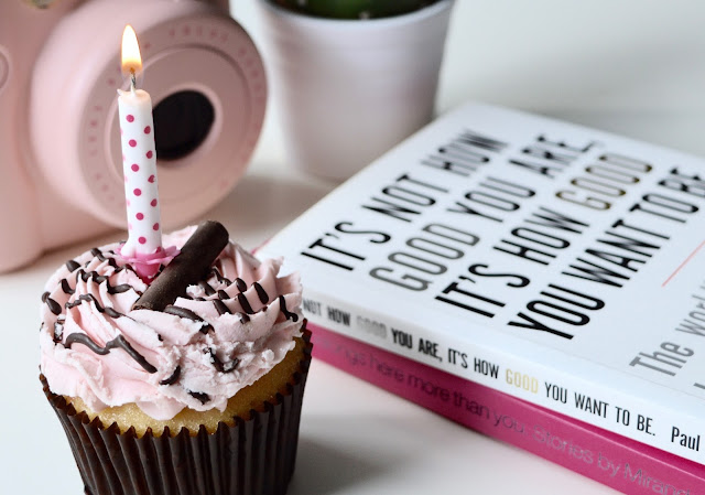 pink birthday cupcake and candle