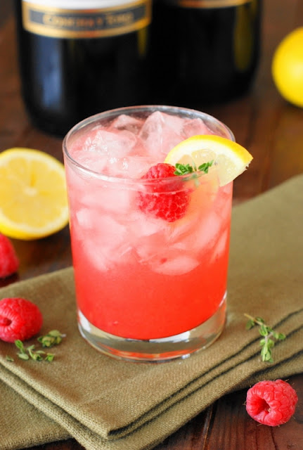 Grab your jar of honey and a few fresh raspberries to whip up this delicious pretty-in-pink Moscato Honey Bee Cocktail.  Its gorgeous pink hue would go just beautifully with Easter brunch, Mother's Day lunch, a bridal shower, or simple front porch sipping.