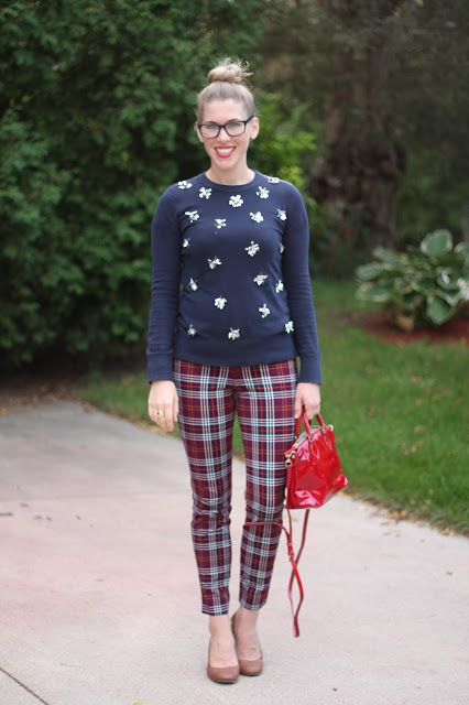 plaid pants, navy embellished sweater, dooney and burke red bag