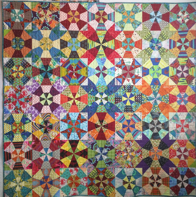 Multicolored fabrics create this scrap kaleidoscope variation.