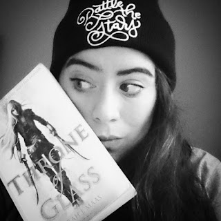 Self portrait with Throne of Glass, and a beanie hat from Fairyloot