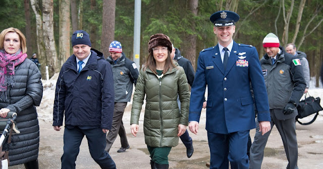 At the Gagarin Cosmonaut Training Center in Star City, Russia, Expedition 59 crew members Alexey Ovchinin of Roscosmos (second from left), Christina Koch of NASA (second from right) and Nick Hague of NASA (right) walk to a bus Feb. 26 to take them to their plane for a flight to their launch site at the Baikonur Cosmodrome in Kazakhstan for final pre-launch training. They will launch on March 14, U.S. time, on the Soyuz MS-12 spacecraft from the Baikonur Cosmodrome in Kazakhstan for a six-and-a-half month mission on the International Space Station. Credit: NASA/Beth Weissinger